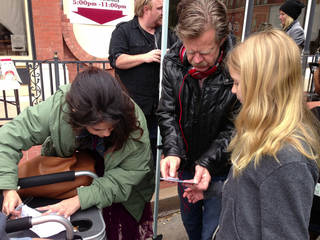 """Actress Selena Gomez, director William H. Macy and Macy's daughter, Sophia Grace, talk on the set of the Oklahoma-made musical drama """"Rudderless,"""" which is Macy's feature film directorial debut."""