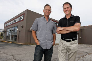 Co-owners and developers Ben Sellers, left, and David Wanzer are set to redevelop a former B.F. Goodrich tire shop at 916 NW 6 into restaurant and retail space. Photo by Nate Billings, The Oklahoman NATE BILLINGS - NATE BILLINGS