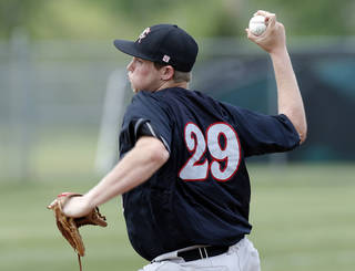 Carl Albert's Gavin LaValley pitches during the 2013 Class 5A state tournament. LaValley hit .477 with 75 RBIs last year. Photo by Sarah Phipps, The Oklahoman Archives