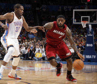 Miami's LeBron James (6) drives past Oklahoma City's Kevin Durant (35) during the NBA basketball game between the Miami Heat and the Oklahoma City Thunder at Chesapeake Energy Arena in Oklahoma City, Sunday, March 25, 2012. Photo by Sarah Phipps The Oklahoman