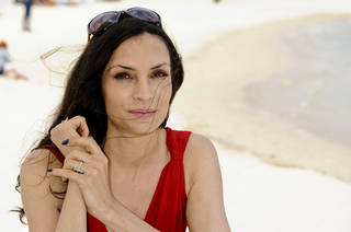 Actress Famke Janssen poses for portraits at the American Pavilion at the 64th international film festival, in Cannes, southern France, Friday, May 13, 2011. (AP Photo/Jonathan Short) ORG XMIT: CANDJ126