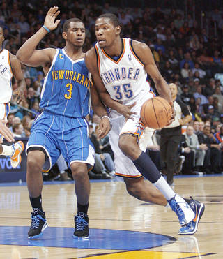 OKC's Kevin Durant tries to get around the Hornets' Chris Paul during action Wednesday at the Ford Center. Durant scored 27 points in defeat. Photo by Bryan Terry, The Oklahoman
