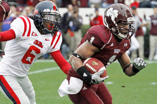 Mississippi State receiver Chad Bumpus runs for a touchdown during the Bulldogs' 41-27 win over Ole Miss on Nov. 28. AP PHOTO