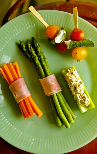 Kabobs, Stuffers and Wrap Arounds: Can be as simple as Celery with Tuna, peanut or almond butters even pimento cheese. Make it portable by sending along a plastic knife and the stuffing in a small container. Ham Roll Ups can be assembled in advance or wrapped around a bundle of veggies. CHRIS LANDSBERGER - CHRIS LANDSBERGER