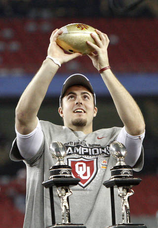 Oklahoma's Landry Jones (12) holds part of the trophy after the Fiesta Bowl college football game between the University of Oklahoma Sooners and the University of Connecticut Huskies in Glendale, Ariz., at the University of Phoenix Stadium on Saturday, Jan. 1, 2011. Photo by Bryan Terry, The Oklahoman