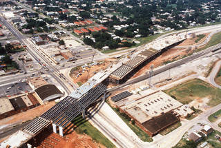 Construction on the elevated section of Centennial Expressway (Interstate 235) is seen as it goes over NE 23 just east of Broadway Avenue, in this photo from 1987. View is looking northwest. The highway changed and quieted residential neighborhoods in the area north of downtown. The Oklahoman archives