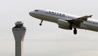 In this 2013 file photo, a United Airlines jet departs in view of the air traffic control tower at Seattle-Tacoma International Airport in Seattle. United Continental Holdings Inc. on Thursday said that net income in the second quarter was $789 million. The results topped analysts' expectations and marked a turnaround from the first quarter, when United was the only major U.S. carrier to report a loss. AP File Photo Elaine Thompson - AP