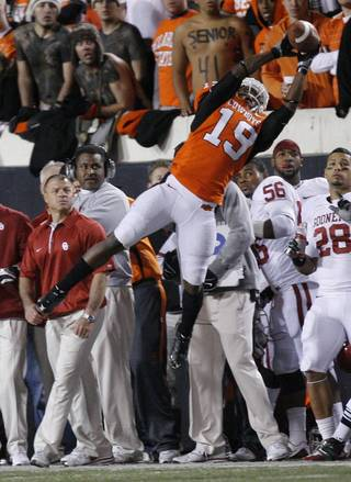 Oklahoma State's Brodrick Brown (19) tips Oklahoma's Landry Jones (12) pass in bounds for an interception during the Bedlam college football game between the University of Oklahoma Sooners (OU) and the Oklahoma State University Cowboys (OSU) at Boone Pickens Stadium in Stillwater, Okla., Saturday, Nov. 27, 2010. Photo by Sarah Phipps, The Oklahoman ORG XMIT: KOD