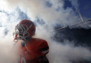 The Oklahoma State Cowboys take to the field during the college football game between the Oklahoma State University Cowboys (OSU) and Texas Tech University Red Raiders (TTU) at Boone Pickens Stadium on Saturday, Nov. 17, 2012, in Stillwater, Okla. Photo by Chris Landsberger, The Oklahoman
