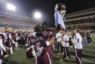 CLASS 6A HIGH SCHOOL FOOTBALL STATE CHAMPIONSHIP GAME / CELEBRATION: Jenks' Jordan Smallwood (2) and Trey'Vonne Barr'e (5) celebrate the win over Norman North during the Class 6A Oklahoma state championship football game between Norman North High School and Jenks High School at Boone Pickens Stadium on Friday, Nov. 30, 2012, in Stillwater, Okla. Photo by Chris Landsberger, The Oklahoman