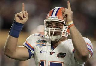 Florida's Tim Tebow signals a touchdown after David Nelson scored in the fourth quarter of the BCS Championship NCAA college football game against Oklahoma in Miami, Thursday, Jan. 8, 2009. (AP Photo/Lynne Sladky)