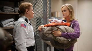 "Taylor Schilling, right, stars in ""Orange is the New Black,"" a new original series on Netflix created by Jenji Kohan (""Weeds"")."