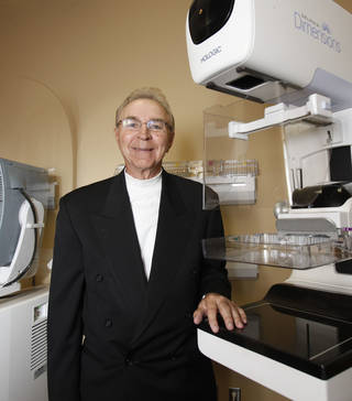 Dr. Larry Killebrew stands beside one of the new machines at the Oklahoma Breast Care Center in Oklahoma City on Thursday. Photo by Paul Hellstern, The Oklahoman PAUL HELLSTERN