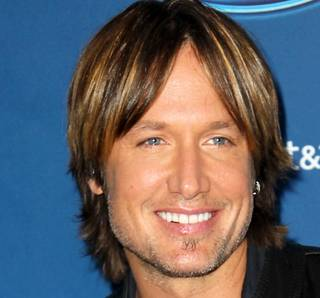 "FILE - This Jan. 9, 2013 file photo shows Keith Urban at the ""American Idol"" premiere event at Royce Hall on the campus of UCLA in Los Angeles. Urban is a judge on the singing competition series airing Wednesdays and Thursdays on Fox. (Photo by Matt Sayles/Invision/AP, file) ORG XMIT: NYET476"
