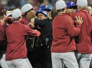 Florida State's Jameis Winston is held back by a cop as he takes part in a bench-clearing fight in the 8th inning against Florida Tuesday. Photo by Florida Times-Union