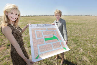 Sharla Wilson, a Central Oklahoma Habitat for Humanity board member, and Ann Felton Gilliland, CEO and president, stand at the latest Habitat neighborhood, Legacy Estates, northeast of Wilshire Boulevard and Council Road. PHOTO BY DAVID McDANIEL, THE OKLAHOMAN David McDaniel -