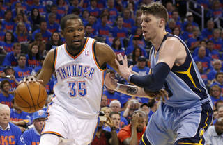 Oklahoma City's Kevin Durant (35) goes past Memphis' Mike Miller (13) during Game 7 in the first round of the NBA playoffs between the Oklahoma City Thunder and the Memphis Grizzlies at Chesapeake Energy Arena in Oklahoma City, Saturday, May 3, 2014. Photo by Nate Billings, The Oklahoman