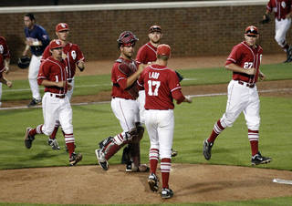 Oklahoma players celebrate their 5-4 victory over Virginia in their NCAA college baseball regional game in Charlottesville, Va., Sunday, June 3, 2012. (AP Photo/The Daily Progress, Andrew Shurtleff) ORG XMIT: VACHA302