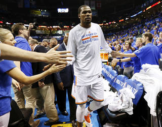 Oklahoma City's Kevin Durant (35) leaves the floor after Game 7 in the first round of the NBA playoffs between the Oklahoma City Thunder and the Memphis Grizzlies at Chesapeake Energy Arena in Oklahoma City, Saturday, May 3, 2014. The Thunder won 120-109. Photo by Nate Billings, The Oklahoman