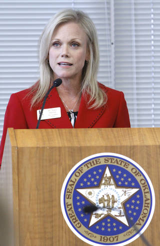 Broken Arrow Chief Academia Officer Janet Dunlop addresses the Board of Education deciding to grant high school diplomas to several Oklahoma students who failed state-mandated end-of-instuction exams, Tuesday, June 5, 2012. Photo By David McDaniel/The Oklahoman