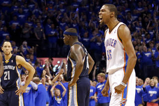 Oklahoma City's Kevin Durant (35) celebrates a Memphis turnover in front of Memphis' Zach Randolph (50) in the final seconds of Game 1 in the second round of the NBA playoffs between the Oklahoma City Thunder and the Memphis Grizzlies at Chesapeake Energy Arena in Oklahoma City, Sunday, May 5, 2013. Photo by Sarah Phipps, The Oklahoman