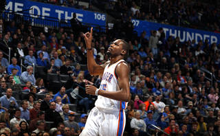 Oklahoma City's Kevin Durant (35) reacts to a play during the NBA basketball game between the Oklahoma City Thunder and the Portland Trail Blazers at the Chesapeake Energy Arena in Oklahoma City, Sunday, March, 24, 2013. Photo by Sarah Phipps, The Oklahoman