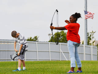 Samuel Turley, 11, and Alyssa Cummings, 10, participate in an archery class at Rose State's Summer Kids College. Photo by Dennis Gosnell, Rose State College public relations intern PROVIDED