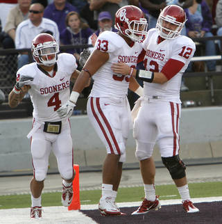 Oklahoma Sooners' Trey Millard (33) celebrates with Kenny Stills (4) and Landry Jones (12) after a touchdown during the college football game between the University of Oklahoma Sooners (OU) and the Kansas State University Wildcats (KSU) at Bill Snyder Family Stadium on Sunday, Oct. 30, 2011. in Manhattan, Kan. Photo by Chris Landsberger, The Oklahoman ORG XMIT: KOD