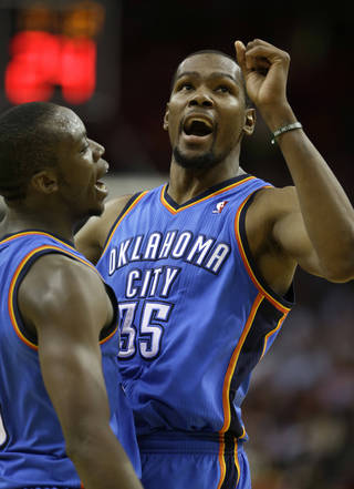 The Thunder's Kevin Durant, right, celebrates Reggie Jackson's 3-point basket during Thursday's victory against the Rockets. AP Photo
