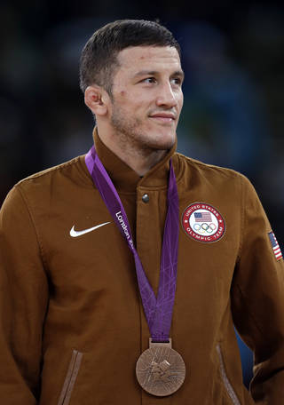 U.S. / UNITED STATES / TEAM USA / WRESTLING: Bronze medalist Coleman Scott of the United States poses with his medal during the victory ceremony for the men's 60-kg freestyle wrestling competition at the 2012 Summer Olympics, Saturday, Aug. 11, 2012, in London. (AP Photo/Paul Sancya) ORG XMIT: OWRE209