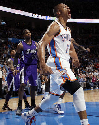 Oklahoma City's Russell Westbrook (0) reacts in front of Sacramento's Isaiah Thomas (22) and Jason Thompson (34) after dunking the ball on a lob pass from Kevin Durant during the NBA basketball game between the Oklahoma City Thunder and the Sacramento Kings at Chesapeake Energy Arena in Oklahoma City, Friday, April 13, 2012. Photo by Nate Billings, The Oklahoman