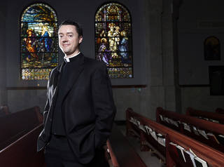 The Rev. Stephen Hamilton stands in St. Monica Catholic Church in Edmond, where he is the new senior pastor. PHOTO BY SARAH PHIPPS, THE oklahoman