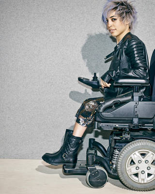 A model in a wheelchair advertising boots in the company's annual July anniversary catalog, which is its biggest sale event of the year with preview discounts on new fashions for fall. AP Photo Mary Rozzi