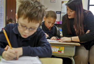 Second grade teacher Jennifer Lopez works with a student at Putnam Heights Elementary in Oklahoma City, Okla. on Monday, Nov. 25, 2013. Photo by Chris Landsberger, The Oklahoman.