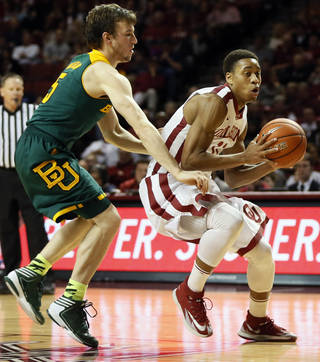 Oklahoma's Isaiah Cousins (11) takes the ball past Baylor's Brady Heslip (5) during an NCAA men's college basketball game between Baylor and the University of Oklahoma at Lloyd Noble Center in Norman, Okla., Saturday, Feb. 8, 2014. OU won, 88-72. Photo by Nate Billings, The Oklahoman