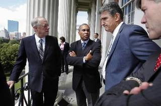 Massachusetts Gov. Deval Patrick, center, speaks with fellow governors, from left, Tennessee Gov. Phil Bredesen, West Virginia Gov. Joe Manchin and Virginia Gov. Bob McDonnell on the balcony at the Statehouse in Boston, Friday, July 9, 2010. Patrick is host to the annual meeting of the National Governors Association taking place in Boston through July 11. (AP Photo/Michael Dwyer)
