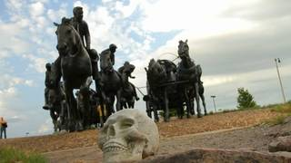 Shown is one of the 39 skulls artist Geoffrey Krawczyk placed around the Centennial Land Run Monument in Bricktown on June 16. Each skull represented a federally recognized Indian tribe in Oklahoma. - Photo by Liz Chow