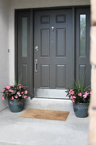 """A new handle, door knocker and kick plate can give an old door a fresh look, one that says, """"Someone cares."""" PHOTO PROVIDED BY JENNIFER STAGG"""