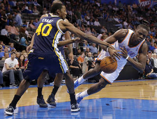 Oklahoma City Thunder's Reggie Jackson (15) falls to the court after being fouled by Utah Jazz's Jeremy Evans (40) during the NBA basketball game between the Oklahoma City Thunder and the Utah Jazz at Chesapeake Energy Arena on Wednesday, March 13, 2013, in Oklahoma City, Okla. Photo by Chris Landsberger, The Oklahoman