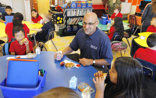Oklahoma City Public School Superintendent Rob Neu sits down to eat breakfast with third graders in Jane White's classroom at Mark Twain Elementary in Oklahoma City Monday, Aug. 4, 2014. Photo by Paul B. Southerland, The Oklahoman