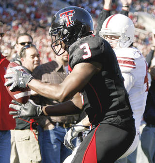 Texas Tech's Jamar Wall intercepts a Ryan Broyles pass intended for OU's Trent Ratterree. Photo by Bryan Terry, The Oklahoman