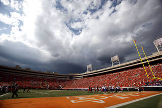 Storm clouds build during the first half of the college football game between the Oklahoma State University Cowboys (OSU) and the University of Kansas Jayhawks (KU) at Boone Pickens Stadium in Stillwater, Okla., Saturday, Oct. 8, 2011. Photo by Sarah Phipps, The Oklahoman