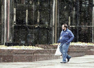 Snow falls Monday at Leadership Square in downtown Oklahoma City. By Paul Hellstern, The Oklahoman