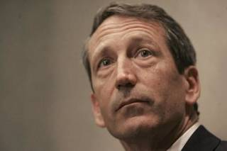 In this April 3, 2009 file photo, South Carolina Gov. Mark Sanford fields questions during a news conference in Columbia, S.C. Gov. Sanford told a newspaper Wednesday, June 24, 2009 that he was in Argentina during his unexplained 5-day absence, not hiking along the Appalachian Trail as his office previously said. (AP Photo/Mary Ann Chastain, file)