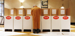 A man votes in a booth at precinct 204, St. Luke's United Methodist Church, in Oklahoma City on Feb. 12. Photo by Paul B. Southerland, The Oklahoman PAUL B. SOUTHERLAND