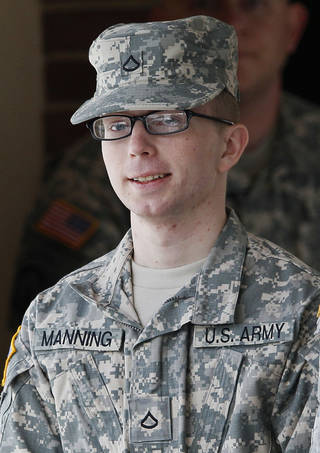 In this photo taken Dec. 22, 2011, Army Pfc. Bradley Manning, 24, a native of Crescent, Okla., is escorted from a courthouse in Fort Meade, Md. An Army officer is recommending a general court-martial for Manning, a low-ranking intelligence analyst charged in the biggest leak of classified information in U.S. history. (AP Photo/Patrick Semansky)