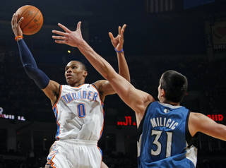 Oklahoma City's Russell Westbrook (0) takes a shot past Darko Milicic (31) of Minnesota during the NBA basketball game between the Minnesota Timberwolves and the Oklahoma City Thunder at the Oklahoma City Arena, Monday, November 22, 2010, in Oklahoma City. Photo by Nate Billings, The Oklahoman