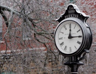 An ice-covered clock in downtown Perkins during a winter storm, in Perkins, Okla., Monday, December 10, 2007. By Matt Strasen, The Oklahoman