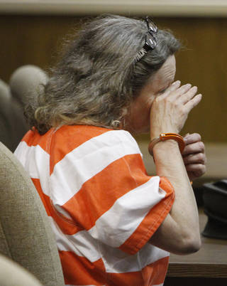 Rebecca Bryan wipes tears from her face as she talks to her defense attorney Gary James in the Canadian County Courthouse in El Reno , Wednesday May 1, 2013. Bryan is accused of killing her husband, Keith Bryan, 52, who was the Nichols Hills Fire Chief. Photo By Steve Gooch, The Oklahoman