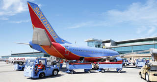 Workers unload a Southwest Airlines flight at Will Rogers World Airport in Oklahoma City. Photo by Steve Gooch, The Oklahoman Archives